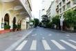 Ảnh: Đường phố vắng lặng trong ngày đầu TP.HCM giãn cách theo Chỉ thị 16