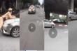 Tạm giữ tài xế taxi hất Trung úy CSGT Hà Nội lên nắp capô