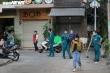 Ảnh: Phong tỏa một chung cư ở phố đi bộ Bùi Viện