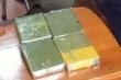 Giấu 4 bánh heroin trong bao gạo mang từ Cao Bằng về Hà Nội