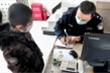 Cậu bé 9 tuổi quyên góp toàn bộ tiền tiết kiệm gửi bệnh viện Vũ Hán