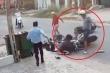 Clip người đàn ông đánh, đạp liên tiếp vào mặt nữ sinh sau va chạm giao thông